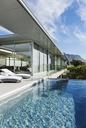 Patio and pool along modern house - CAIF19937