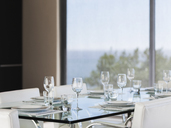 Set table in modern dining room - CAIF19943