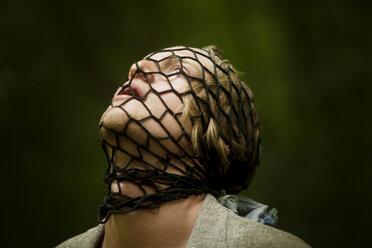 Man's face tied up in net - CAVF10686