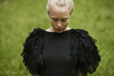 Sad woman on field - CAVF10770