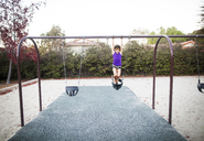 Girl playing on swing at park - CAVF11043