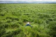 Man relaxing on grassy field - CAVF11346