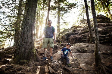 Father and son hiking in forest - CAVF11745