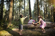 Children playing with toys in forest - CAVF11754