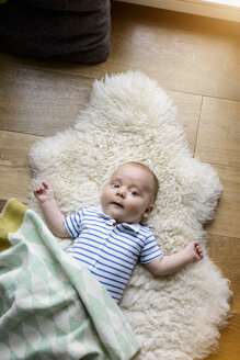 Portrait of new born lying on lambskin - BMOF00054