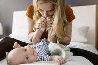 Mother kissing baby boy's feet - BMOF00060