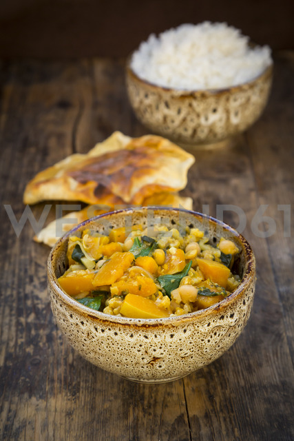 Curry dish with cauliflower, butternut pumpkin, spinach and coriander, papadam and rice - LVF06796