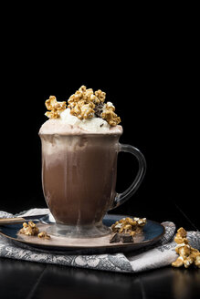 Close-up of hot chocolate with whipped cream and caramel popcorn - CAVF12203