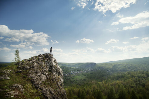 Man standing on cliff against sky - CAVF12917