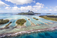 Scenic view of Bora Bora island against cloudy sky - CAVF13334