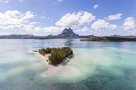Aerial view of lagoon in Bora Bora island against cloudy sky - CAVF13337