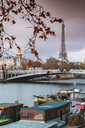 Pont Alexandre III over Seine river by Eiffel Tower against cloudy sky - CAVF13409
