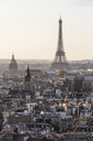 Eiffel tower in city against clear sky during sunset - CAVF13412