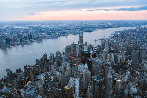 High angle view of One World Trade Center by Hudson river in city at dusk - CAVF13430