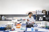 Senior female scientist using pipette during experiment in laboratory - CAVF14987