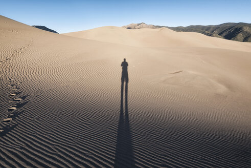 Shadow of person on sand - CAVF15140
