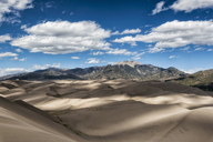 Scenic view of sand dunes against mountains - CAVF15149