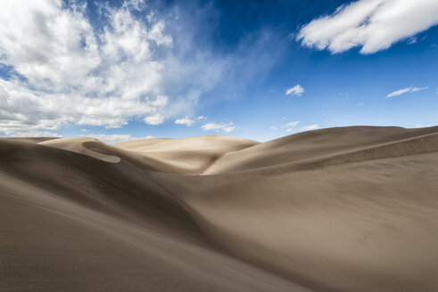 Scenic view of sand dunes against blue sky - CAVF15155