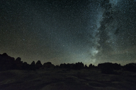 Silhouette landscape against star field at night - CAVF15179
