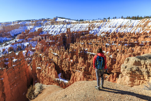 Rear view of hiker standing on mountain against clear sky at Bryce Canyon National Park - CAVF15332