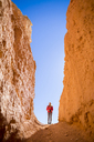 Low angle view of hiker standing by rock formations at Bryce Canyon National Park - CAVF15335