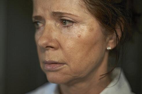 Close-up of sad woman looking away - CAVF15493