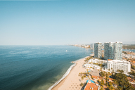 Mexico, Jalisco, Puerto Vallarta, View of beach with hotels and port in the background - ABAF02204