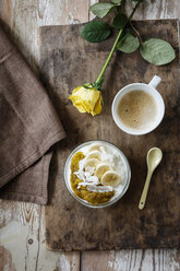 Chia mango yogurt with banana and cup of coffee - EVGF03310