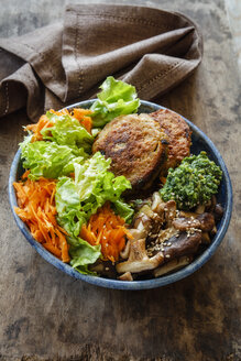 Buddha Bowl, salad with carrot, quinoa fritters, shitake mushrooms and ramson paste - EVGF03313