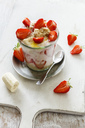 Strawberry banana parfait with oat flakes and yogurt in glass - EVGF03319