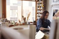 Female artist working in workshop - CAVF16453