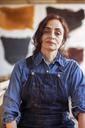 Portrait of confident female artist standing in workshop - CAVF16459