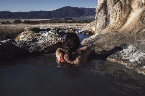 Rear view of woman relaxing in Bridgeport Hot Springs - CAVF16700