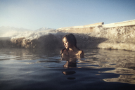 Woman relaxing in Mammoth Lake Hot Springs - CAVF16706