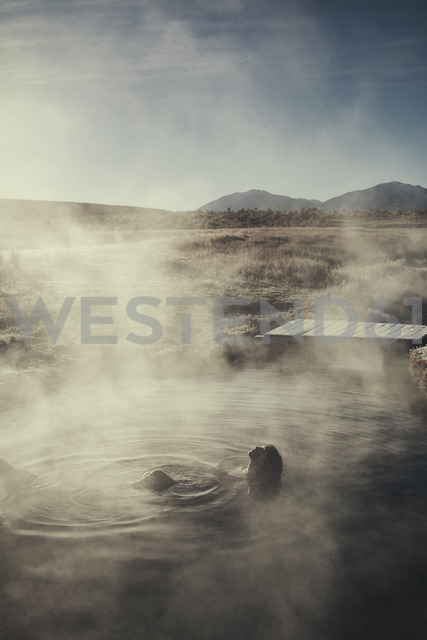 High angle view of woman swimming in Mammoth Lake Hot Springs - CAVF16709