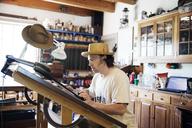 Mature male carpenter working in workshop - CAVF16913