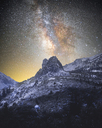 Low angle view of mountain against star field - CAVF16922