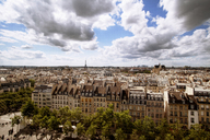Aerial view of cityscape with Eiffel tower against cloudy sky - CAVF17552