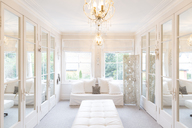 White, luxury home showcase interior dressing room with mirrored closets - CAIF20143