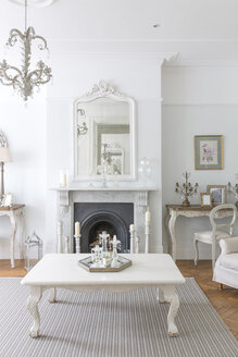 White, luxury home showcase interior living room with fireplace - CAIF20146