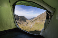 Scenic view of mountains seen through tent - CAVF17857