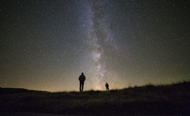 Friends standing against star field at night - CAVF17860