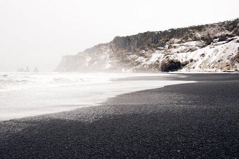 Cliffs overlooking misty beach during winter - CAVF17998