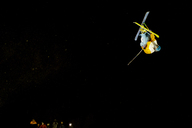 Man performing freestyle skiing jump at night - CAVF19240