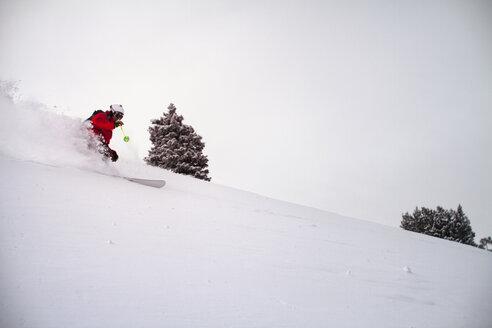 Man skiing on snow slope against sky - CAVF19399