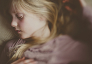 Overhead view of girl sleeping on bed - CAVF20434
