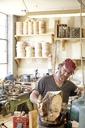 Carpenter using machinery in workshop - CAVF21121