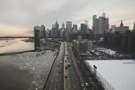 Cityscape by Brooklyn Bridge against cloudy sky during sunset - CAVF21202