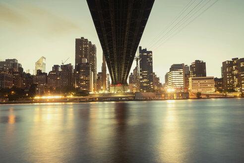 Queensboro Bridge and illuminated skyline against sky - CAVF21238