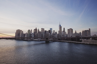 City skyline by East River during sunset - CAVF21337